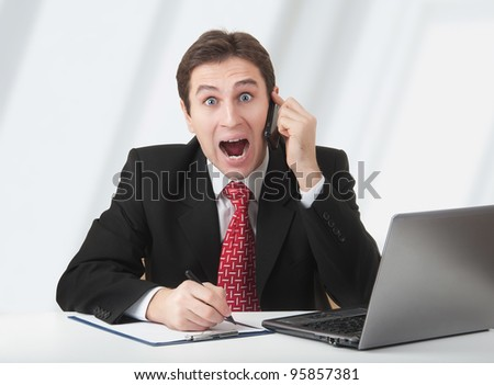 surprised  business man talking on the phone, experiences fear and stress and surprise - stock photo