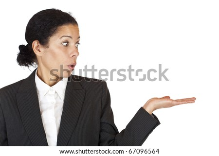 Surprised business woman looks at palm with space for advertisement. Isolated on white background. - stock photo