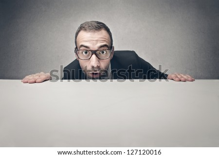 surprised businessman with blank billboard - stock photo