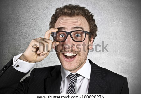 Surprised businessman with glasses - stock photo