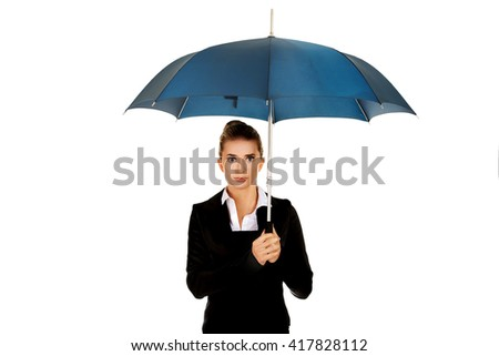 Surprised businesswoman holding an umbrella