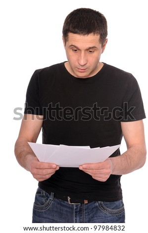 surprised by a man reading documents isolated on white background - stock photo