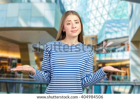 surprised caucasian girl making do not know sign - stock photo