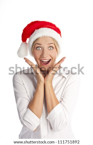 surprised christmas woman wearing a santa hat smiling isolated over a white background - stock photo