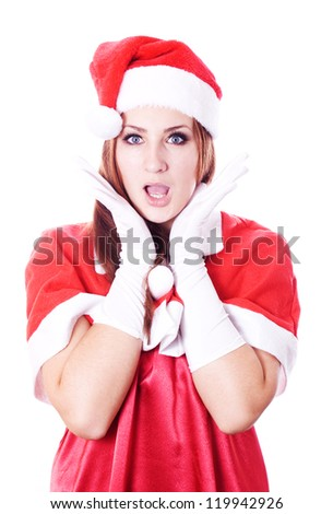 surprised christmas woman wearing a santa hat smiling isolated over a white background