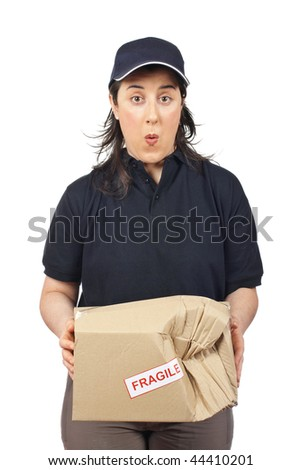 Surprised courier woman holding a damaged package isolated on white background - stock photo