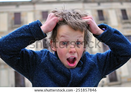 Surprised cute boy with a wide eyes and open mouth - stock photo