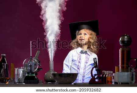 Surprised cute girl looking at evaporation reagent - stock photo