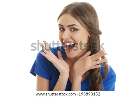 Surprised ecstatic young beautiful woman shouting of joy over white background. - stock photo