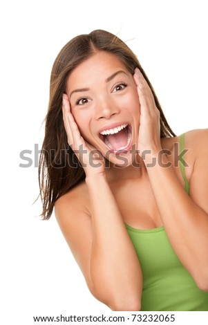 Surprised excited woman screaming amazed in joy. Beautiful young woman isolated on white background in casual green tank top. Asian Caucasian multiracial female model in her 20s. - stock photo