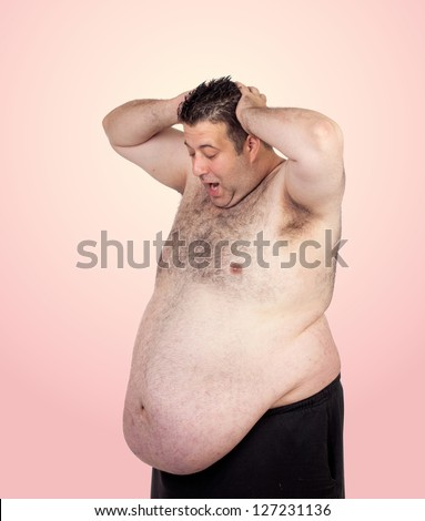 Surprised fat man isolated on a pink background - stock photo