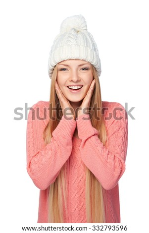 Surprised female in pink knit sweater with hands on cheeks over white studio background - stock photo