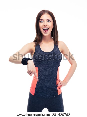 Surprised fitness woman pointing finger down isolated on a white background. Looking at camera - stock photo