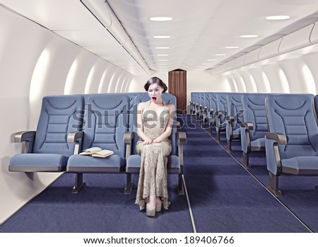 Surprised girl in an airplane. Creative concept - stock photo