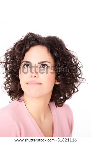 Surprised girl looking at copy space - Portrait of a beautiful young business woman, looking up. - stock photo