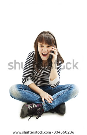 Surprised Girl Using Cell Phone against a white background  - stock photo