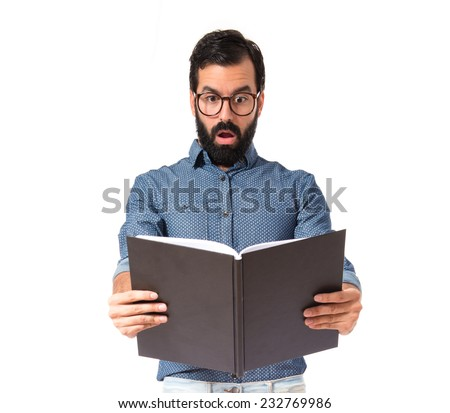 Surprised hipster man reading a book - stock photo
