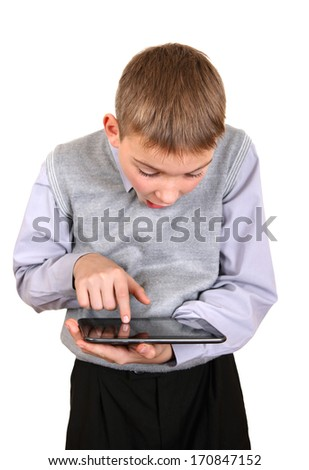 Surprised Kid with Tablet Computer Isolated on the White Background - stock photo