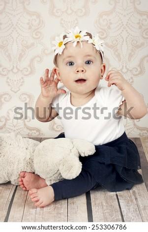 Surprised little baby girl - stock photo