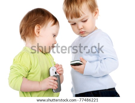 surprised little girl and boy with the phone isolated