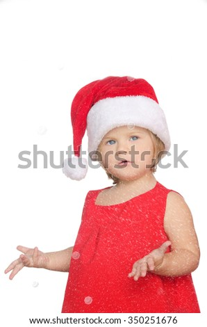 surprised little girl in christmas cap in snow isolated on white - stock photo