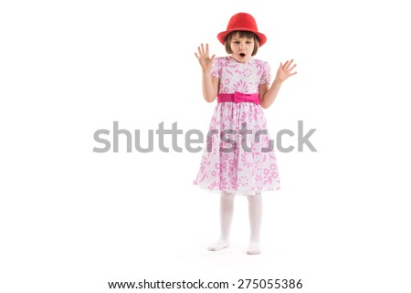 Surprised little girl on a white background - stock photo