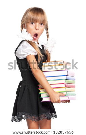 Surprised little girl with books, isolated on white background - stock photo