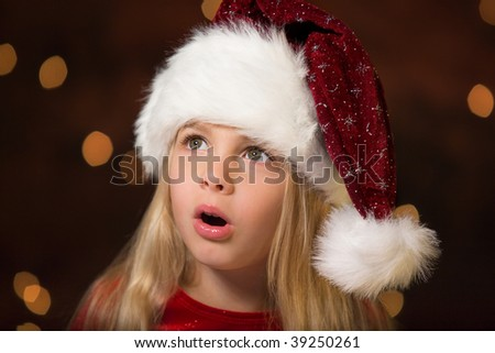surprised little miss santa - stock photo