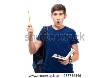 Surprised male student holding book and pencil isolated on a white background. Looking at camera - stock photo