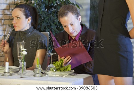 surprised man checking the bill in a restaurant - stock photo