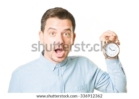 Surprised man holding a little clock - stock photo