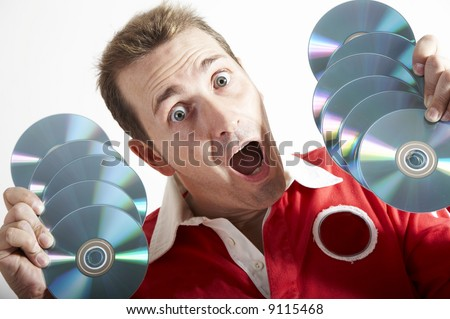 Surprised man holding Cd-roms.