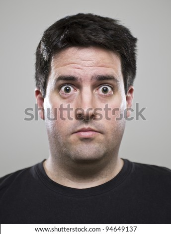Surprised man in a black t-shirt