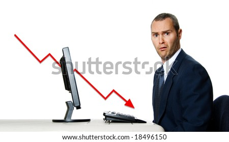 surprised man in blue suit at office computer financial crisis
