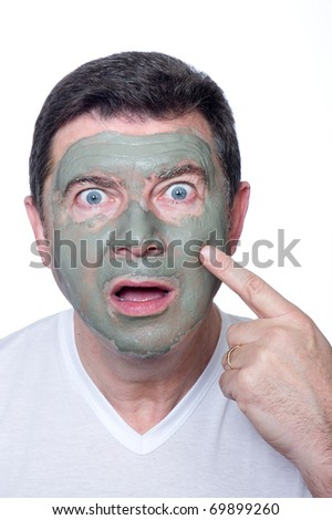 surprised man with beauty mask, skin care - stock photo