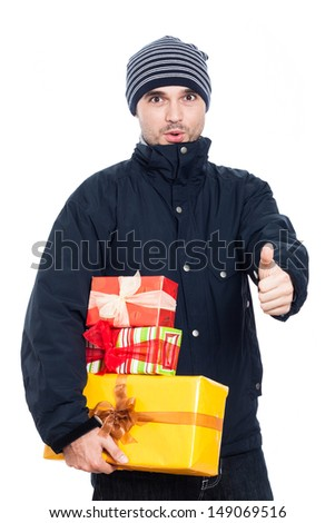Surprised man with presents showing thumb up, isolated on white background. - stock photo