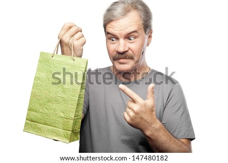 surprised mature man holding shopping bag isolated on white background