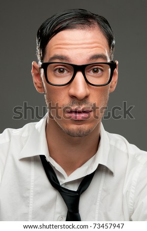 Surprised nerd looking at camera - stock photo