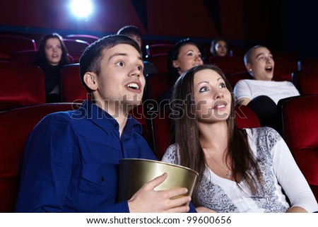 Surprised people in the cinema - stock photo