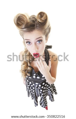 Surprised pinup girl shot from a wide angle view.  Shot on white background. - stock photo