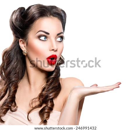 Surprised Retro woman portrait. Beauty vintage girl showing empty copy space on the open hand palm for text, isolated on white background. Proposing a product. Gestures for advertisement. - stock photo