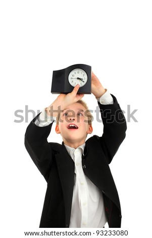 surprised schoolboy with a clock on the white background - stock photo