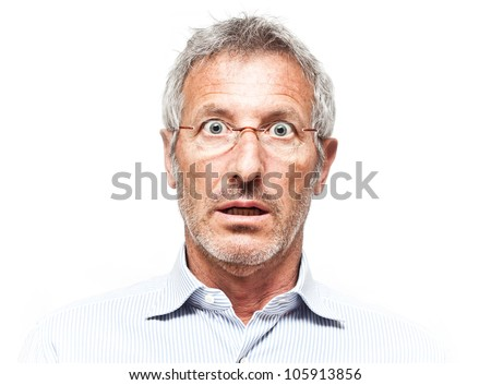 Surprised senior man portrait wearing a pair of glasses isolated on white background - stock photo