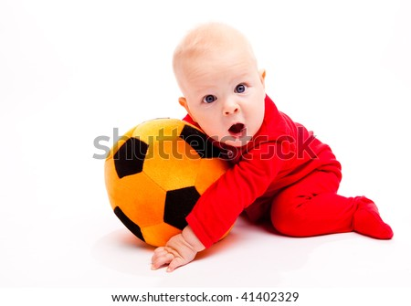Surprised soccer baby with his mouth wide open - stock photo