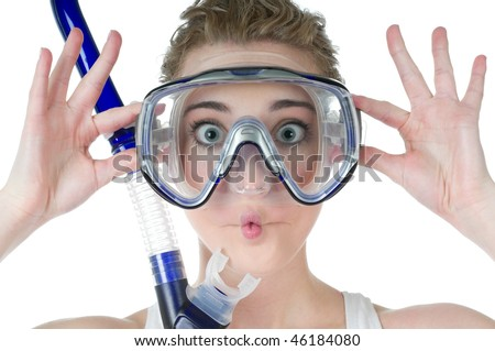 Surprised, wide-opened young woman with scuba mask and snorkel making a funny fish face, puckered lips, isolated on white background