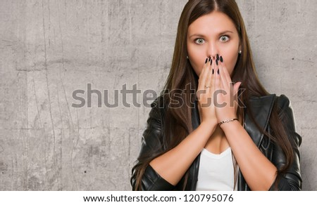 Surprised Woman covering her mouth against a grunge background - stock photo