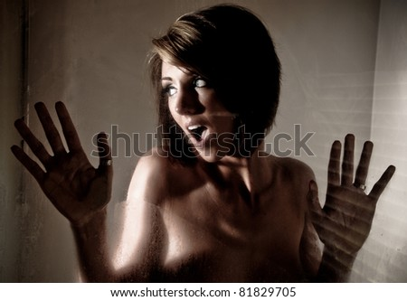 Surprised Woman in the Shower - stock photo