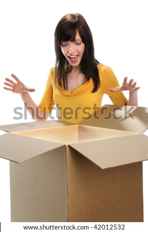 Surprised woman opening box isolated over white background - stock photo