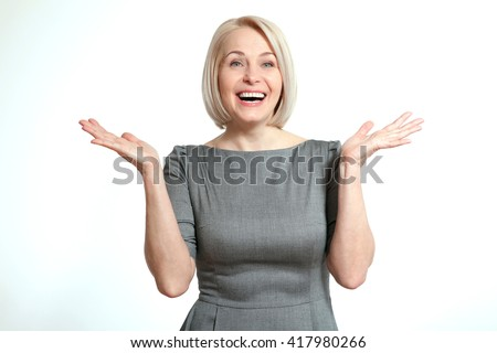 Surprised woman over white background. Human face expression, emotions, feeling attitude reaction - stock photo