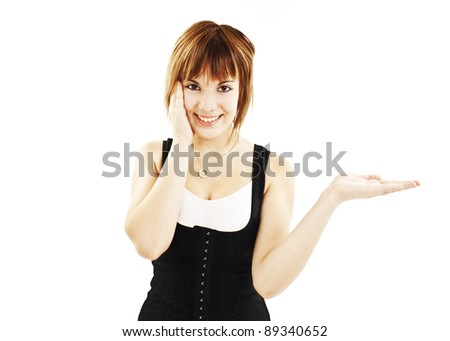 Surprised woman showing open hand palm with copy space for product or text. - stock photo